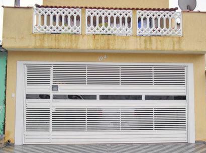 port%C3%A3o de ferro para garagem 410x304 Tipos de portão para garagem do carro residencial
