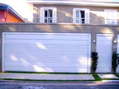 port%C3%A3o de ferro para garagem forte 410x308 Tipos de portão para garagem do carro residencial