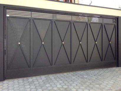 port%C3%A3o de ferro para garagem resistente 410x308 Tipos de portão para garagem do carro residencial