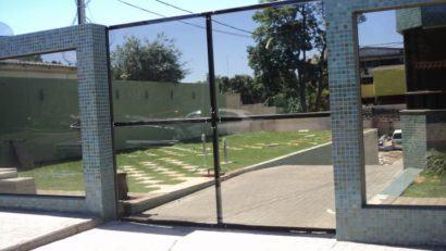 tipos de portao de vidro para garagem