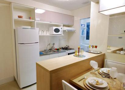 cozinha para apartamento pequeno 410x298 Apartamentos pequenos decorados, A sala, A cozinha e Quarto
